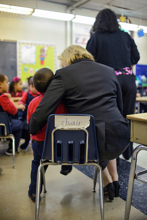 Philadelphia, Pennsylvania - October 24, 2013:<br /> <br /> AARP Experience Corps Philadelphia Branch Director Catherine Mesaros, comforts a distraught student in Brenda Ortiz-Horan's kindergarten class at Cramp Elementary School.