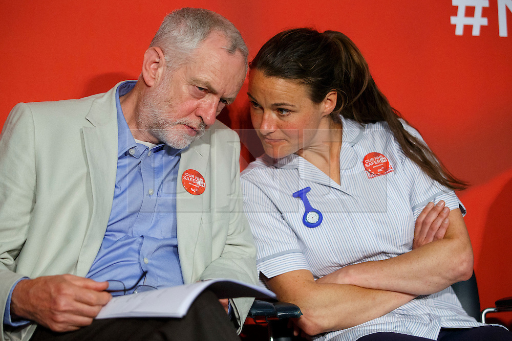 © Licensed to London News Pictures. 14/06/2016. London, UK. Labour Leader JEREMY CORBYN speaks to a midwife before delivering a speech on how NHS is better off in the EU at TUC Conference Centre in London on 14 June 2016. Photo credit: Tolga Akmen/LNP