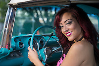 Young woman smiling in a car