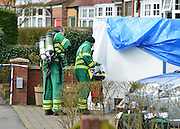 © Licensed to London News Pictures. 13/04/2013. Ruislip, UK An ambulance man with breathing apparatus enters the house. Police and ambulance crews at the scene where a woman and two children have been found dead at a house in Ruislip, West London. Police were called by London Ambulance Service at approx 1840 hrs on Friday 12 April to reports of a woman and two children found deceased at an address in Midcroft Road. Photo credit : Stephen Simpson/LNP