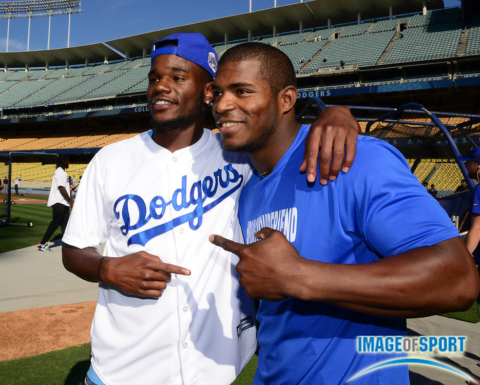 Jun 6, 2016; Los Angeles, CA, USA; Los Angeles Rams receiver Mike Thomas (left) poses with Los Angeles Dodgers right fielder Yasiel Puig before a MLB game against the Colorado Rockies at Dodger Stadium.