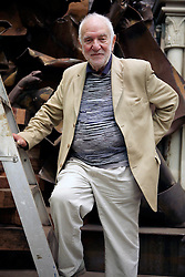 © Licensed to London News Pictures. 24/10/13. UK. Artist Sir Anthony Caro has died at the age of 89. FILE PICTURE dated 05/08/2008  British sculpture Antony Caro poses at his studio in North London on 05/08/2008. Photo credit : Carmen Valino/LNP