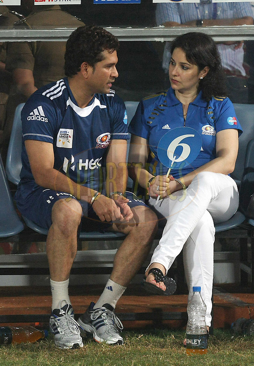 Sachin Tendulkar chats to his wife Anjali during the 2nd Semi Final of the NOKIA Champions League T20 ( CLT20 ) between Somerset and the Mumbai Indians held at the M. A. Chidambaram Stadium in Chennai , Tamil Nadu, India on the 8th October 2011..Photo by Shaun Roy/BCCI/SPORTZPICS