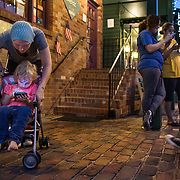 OCCOQUAN, VA - AUG4: Jennifer Armitage, 27, and her daughter Marley, 3, play Pokemon Go in Occoquan, Virginia, August 4th, 2016. This sleepy Virginia town has become a hotspot for Pokemon Go. Throughout the night, kids and young adults play the game on the streets, leaving beer bottles and litter behind. A few residents have complained to city hall and now the city is hiring extra police officers to handle the new masses. (Photo by Evelyn Hockstein/For The Washington Post)