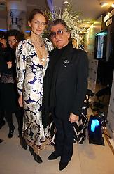 ROBERTO CAVALLI and SAFFRON ALDRIDGE at the launch of Roberto Cavalli Vodka held in the International Designer Room, Harrods, Hans Crescent, London on 5th December 2006.<br /><br />NON EXCLUSIVE - WORLD RIGHTS