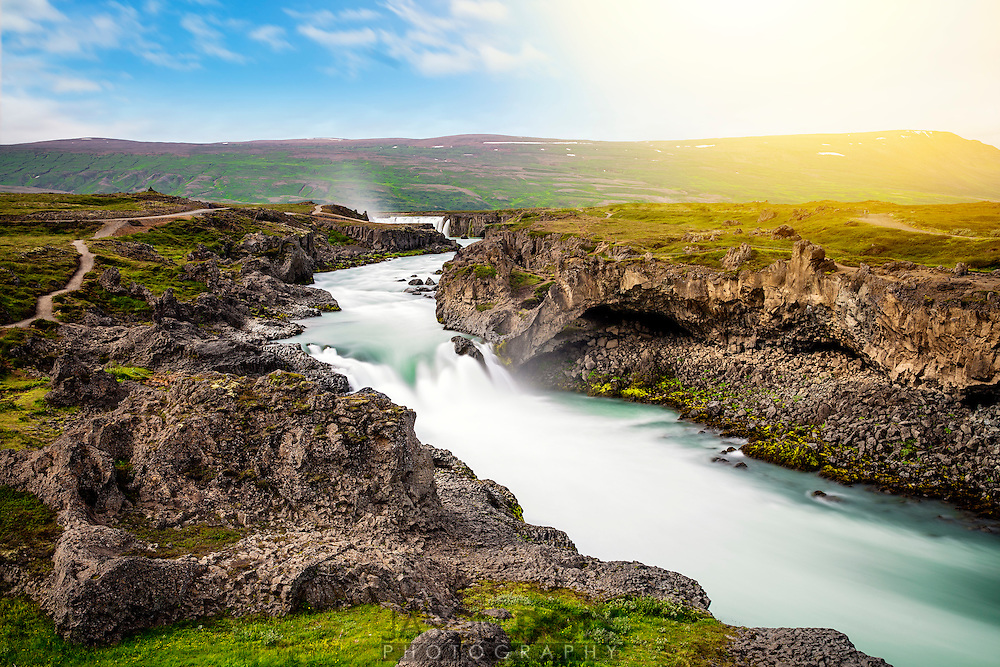 "This is the beautiful Godifoss Waterfall, or ""Waterfall of the Gods."" In the year 1000, Iceland's elected legislature threw the statues of the Nordic gods into the waterfall as a symbol of the country's conversion to Christianity."