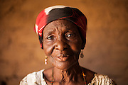 Delou Ibrahim, 70, poses for a photograph at her home in Saran Maradi, Niger. <br /> Delou Ibrahim has four children and suffered the loss of nine. She has about 40 grandchildren, 16 of which live with her. <br /> &quot;I've seen several crises. The famine in 1984 was the hardest. Rains were very weak. The stems of millet came out but the spikes gave no grain - nothing,&quot; she recalls. &quot;Two years ago at least there were people who harvested millet, but this year the crops have been worse because of the drought and the leaf miners.&quot; Delou's last crop was 30kg, which only provided food for about two days.<br /> Delou and her family receive cash from CARE. &quot;I get to buy cereal to feed my family, particularly my grandchildren.&quot; They have two daily meals, porridge in the morning and sorghum paste in the evening.