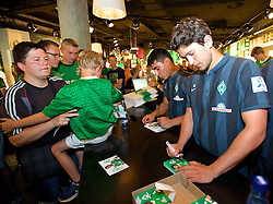 03.08.2014, Weserstadion, Bremen, GER, SV Werder Bremen, Tag der Fans, im Bild Julian von Haacke (SV Werder Bremen #38) und Oezkan / Özkan Yildirim (Bremen #17) bei der Autogrammstunde im Fanshop // during the supporters day of the german 1st Bundesliga Club SV Werder Bremen at the Weserstadion in Bremen, Germany on 2014/08/03. EXPA Pictures © 2014, PhotoCredit: EXPA/ Andreas Gumz<br /> <br /> *****ATTENTION - OUT of GER*****