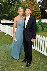 CHRISTIAN CANDY and EMILY CROMPTON at the Royal Parks Foundation Summer Party hosted by Candy & Candy on the banks of the Serpentine, Hyde Park, London on 10th September 2008.