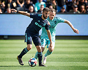 LAFC forward Diego Rossi (9) dribbles past Seattle Sounders forward Harrison Shipp (19) during a MLS soccer match in Los Angeles, Sunday, April 21, 2019. LAFC defeated the Sounders 4-1. (Ed Ruvalcaba/Image of Sport)