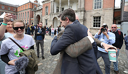 Health Minister Simon Harris hugs Amnesty International Irish Executive Director Colm O'Gorman at Dublin Castle as votes are counted in the referendum on the 8th Amendment of the Irish Constitution which prohibits abortions unless a mother's life is in danger.