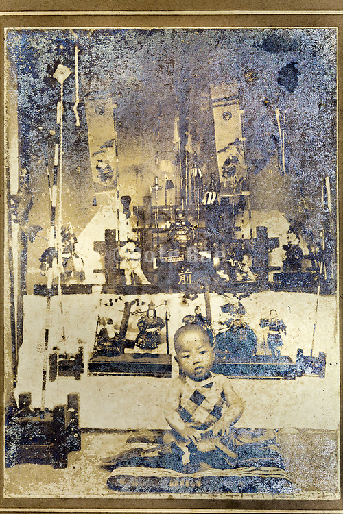severely deteriorating image of Japanese little boy in front of boys day decoration display 1915