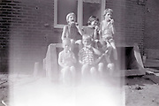 fading photo of children eating ice cream 1960s