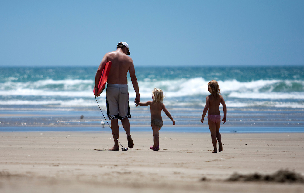 Man and children walking on beach, Napier, New Zealand, Monday, June 11, 2011.  Credit: SNPA / Bethelle McFedries