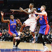07 November 2016: Los Angeles Clippers guard Jamal Crawford (11) passes the ball between Detroit Pistons forward Stanley Johnson (7) and Detroit Pistons forward Jon Leuer (30) during the LA Clippers 114-82 victory over the Detroit Pistons, at the Staples Center, Los Angeles, California, USA.