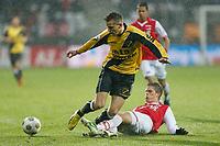 ALKMAAR - Voetbal, AZ - NAC Breda ,  AFAS stadion , Eredivisie , seizoen 2012-2013, 24-02-2013,  NAC Breda speler Mats Seuntjens (l) met AZ speler Markus Henriksen (r ).