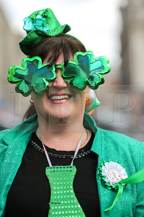 © Licensed to London News Pictures. 17/03/2019. London, UK. A woman during St Patrick's Day as the parade travels through the streets of central London. Photo credit: Dinendra Haria/LNP