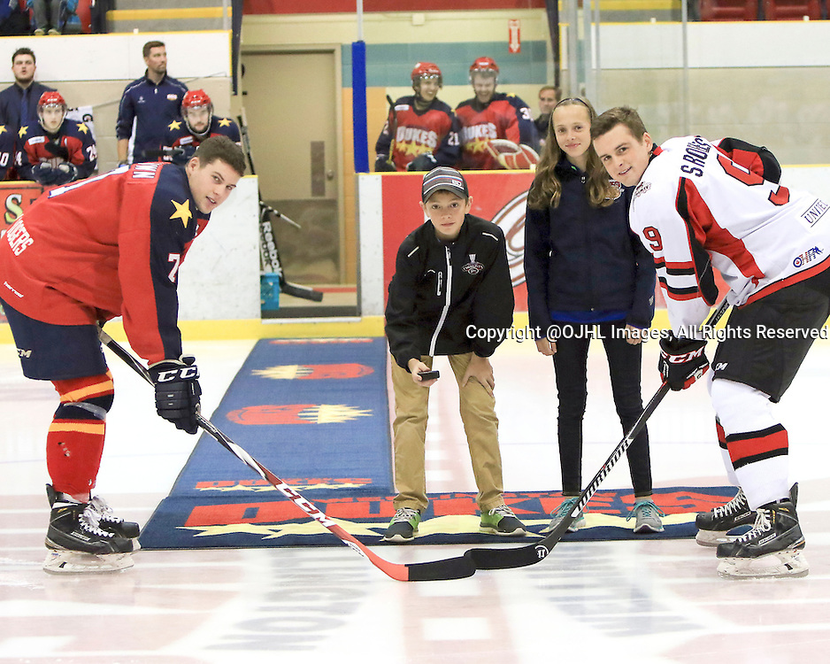 WELLINGTON, ON - Oct 9, 2015 : Ontario Junior Hockey League game action between Stouffville and Wellington ,Luc Brown #7 of the Wellington Dukes and Spencer Roberts #9 of the Stouffville Spirit are joined on the ice by Thomas and Sydney Davies  for the ceremonial face-off<br /> (Photo by Ed McPherson / OJHL Images)