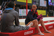 Catalina Ponor, Romania, chat with Marian Dragulescu during the Arthur Gander Memorial,  Morges, Switzerland on 1 November 2017. Photo by Myriam Cawston.