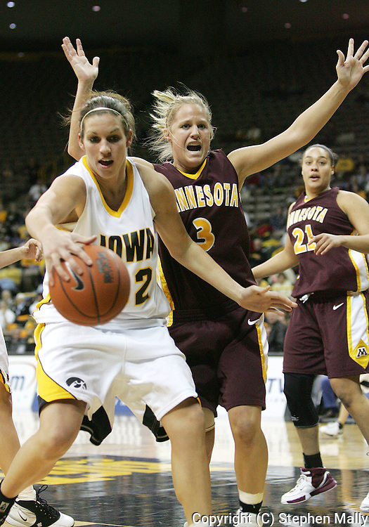 25 JANUARY 2007: Iowa forward Wendy Ausdemore (32) grabs a rebound in front of Minnesota guard Kelly Roysland (3) in Iowa's 80-78 overtime loss to Minnesota at Carver-Hawkeye Arena in Iowa City, Iowa on January 25, 2007.