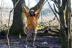 Harefield, UK. 18 January, 2020. Earth protector Freeman celebrates as activists from Extinction Rebellion, Stop HS2 and Save the Colne Valley reoccupy Colne Valley wildlife protection camp from which all but two activists had been evicted by enforcement agents acting for HS2 the previous week during the second day of a three-day 'Stand for the Trees' protest in the Colne Valley timed to coincide with tree felling work by HS2. 108 ancient woodlands are set to be destroyed by the high-speed rail link.