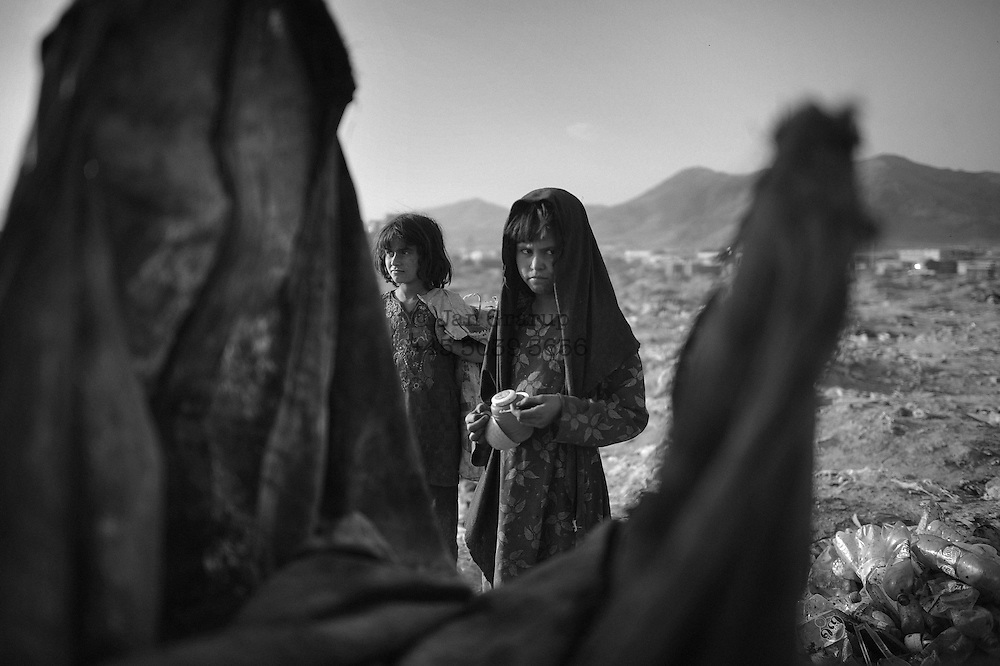 At a garbage dump in the outskirts of Kabul, Afghanistan - a group of people gather every morning. waiting for the garbage trucks from the city arrive. They are waiting for their chance to make a little money in order to survive. Many of the people at the dump are  children who left their families in far regions, hoping for a life in kabul. a better life...