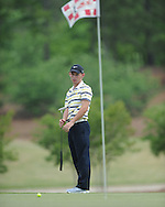 Oxford High's Turner Arnold putts on the 7th hole during the opening round of the MHSAA Class 5A state championship golf tournament at the Ole Miss Golf Course in Oxford, Miss. on Wednesday, May 1, 2013.