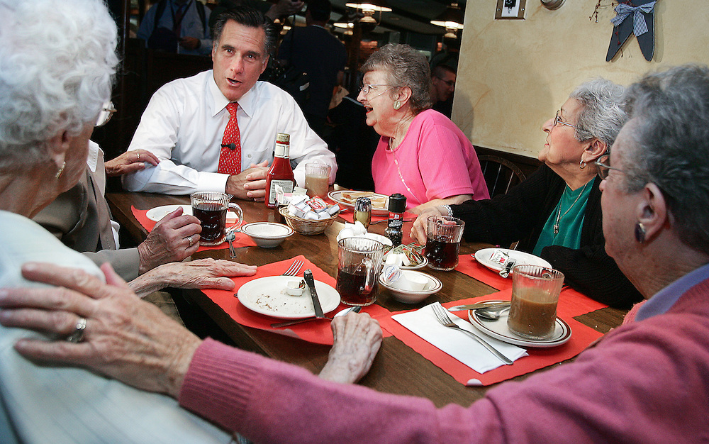 Republican presidential candidate and former Massachusetts Governor Mitt Romney talks to residents during a campaign stop at Harvey's Bakery in Dover, New Hampshire  May 29, 2007.