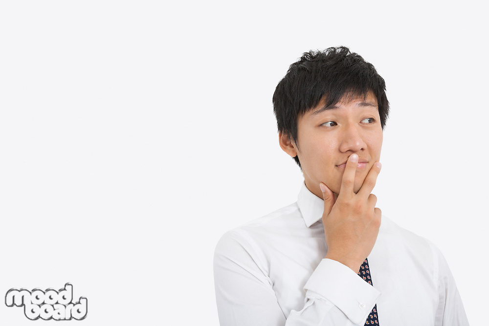 Thoughtful mid adult businessman over white background