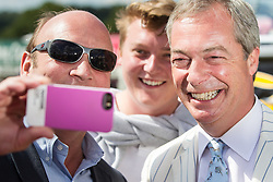 © Licensed to London News Pictures. 31/07/2015. Leeds , UK . NIGEL FARAGE poses for selfies during a visit to the CLA GameFair ( Country Landowners Association ) at Harewood House in Yorkshire . Photo credit: Joel Goodman/LNP