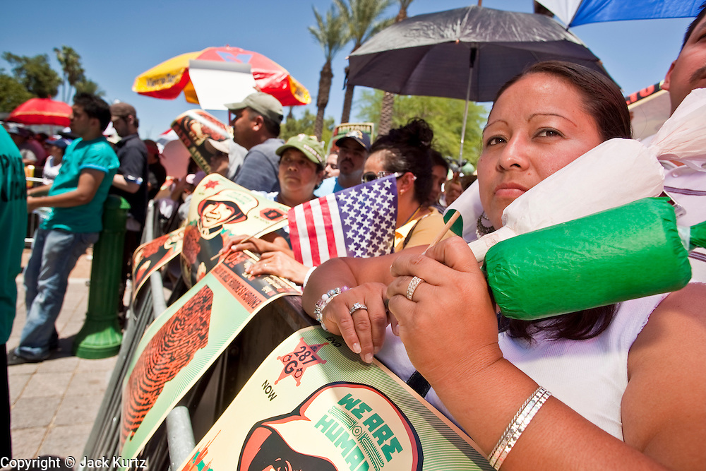 May 29 - PHOENIX, AZ: People at a pro-immigrants rights rally in Phoenix. More than 30,000 people, supporters of immigrants' rights and opposed to Arizona SB1070, marched through central Phoenix to the Arizona State Capitol Saturday. SB1070 makes it an Arizona state crime to be in the US illegally and requires that immigrants carry papers with them at all times and present to law enforcement when asked to. Critics of the law say it will lead to racial profiling, harassment of Hispanics and usurps the federal role in immigration enforcement. Supporters of the law say it merely brings Arizona law into line with existing federal laws.  Photo by Jack Kurtz