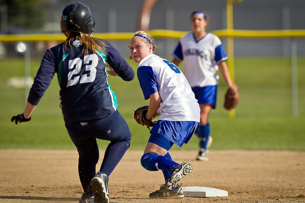 Coeur d'Alene High's second baseman Elli Tindall keeps an eye on Kory Kritz from Lake City as she protects the base.