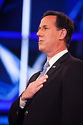 "22 FEBRUARY 2012 - MESA, AZ:   Senator RICK SANTORUM sings the Star Spangled Banner at the Arizona Republican Presidential Debate in the Mesa Arts Center in Mesa, AZ, Wednesday. It is the last debate before the Michigan and Arizona Republican primaries on Feb. 28 and ""Super Tuesday"" on March 6.         PHOTO BY JACK KURTZ"