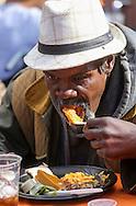 11月25日, 民众享用节日大餐。当天,在美国洛杉矶感恩节前夕,慈善社团为数千贫民区(Skid Row)居民和无家可归者提供免费节日大餐。(新华社发 赵汉荣摄)<br /> A man takes his Thanksgiving meal Wednesday November 25, 2015, in Los Angeles. Thousands of Skid Row residents and homeless people from downtown and beyond were served Thanksgiving dinners during the Los Angeles Mission's annual holiday feast.  (Xinhua/Zhao Hanrong)(Photo by Ringo Chiu/PHOTOFORMULA.com)<br /> <br /> Usage Notes: This content is intended for editorial use only. For other uses, additional clearances may be required.