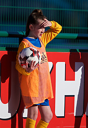 YSTRAD MYNACH, WALES - Wednesday, April 5, 2017: A ball girl shields her eyes from the sun during the Women's International Friendly match against Northern Ireland at Ystrad Mynach. (Pic by Laura Malkin/Propaganda)