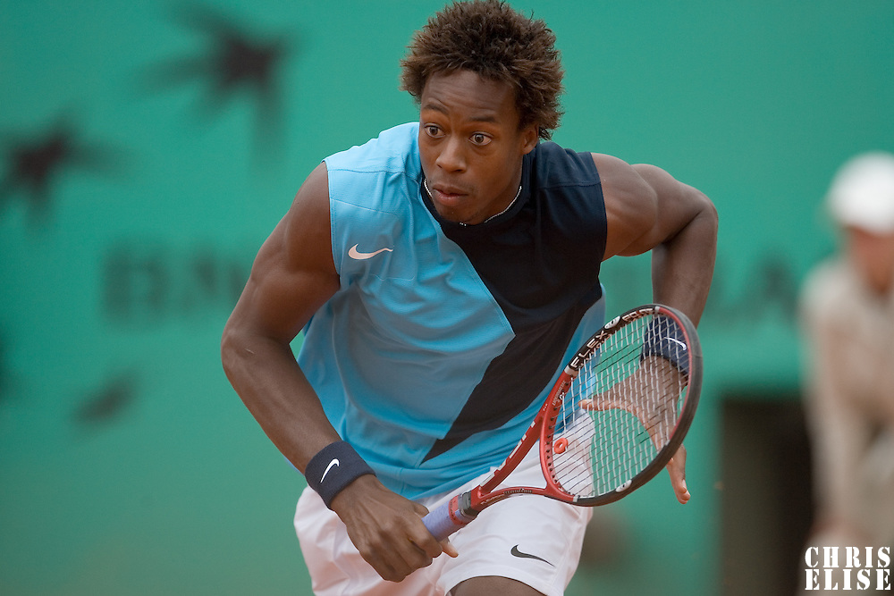 01 June 2007: French player Gael Monfils rushes to the ball during the French Tennis Open third round match won by David Nalbandian 7-6, 5-7, 6-4, 7-6, at Roland Garros, in Paris, France.