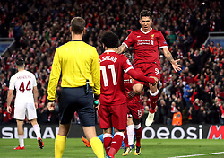Liverpool's Roberto Firmino (right) celebrates scoring his side's fourth goal of the game with Mohamed Salah