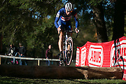 Many men's competitors ride over the log obstacle rather than carry their bicycles.