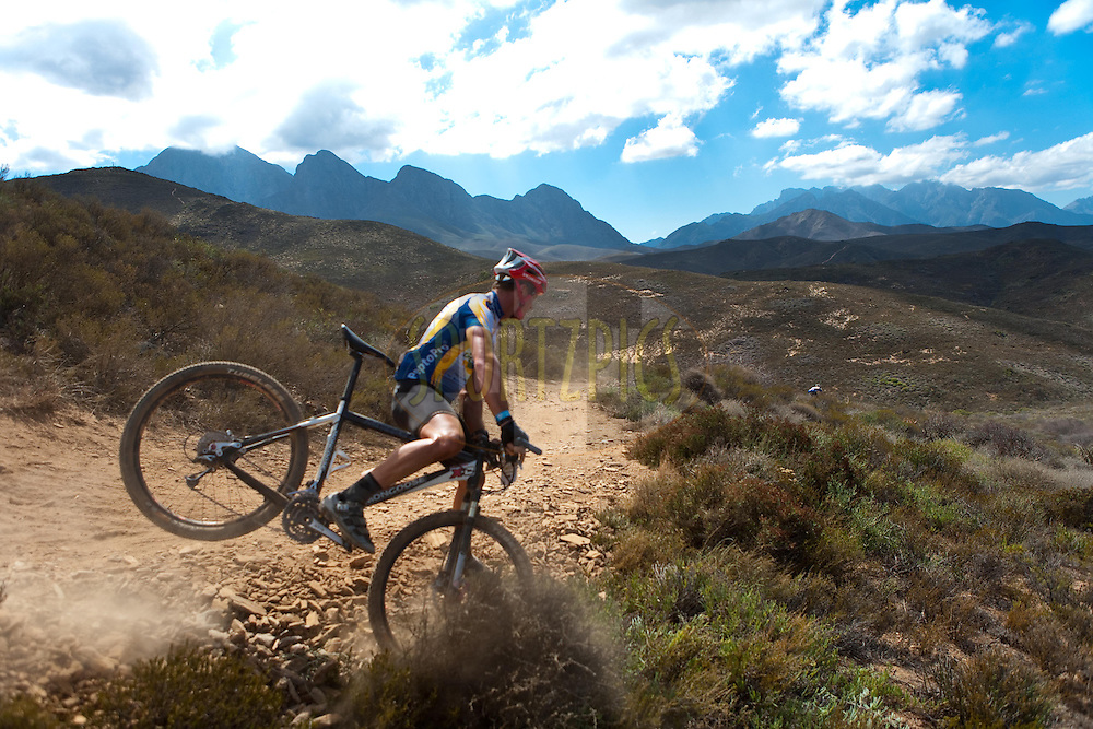 A rider comes short on his way down a steep single track in the mountains above Worcesterduring the (time trial) stage five of the 2010 Absa Cape Epic Mountain Bike stage held in Worcester in the Western Cape, South Africa on the 25 March 2010.Photo by  Karin Schermbrucker/SPORTZPICS