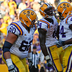 October 8, 2011; Baton Rouge, LA, USA;  LSU Tigers running back Alfred Blue (4) celebrates with teammates following a fourth quarter touchdown run against the Florida Gators at Tiger Stadium. LSU defeated Florida 41-11. Mandatory Credit: Derick E. Hingle-US PRESSWIRE / © Derick E. Hingle 2011