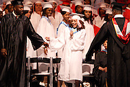 A student does a little dance on the way to her diploma during the Trotwood-Madison High School Commencement at the Victoria Theatre in downtown Dayton, Tuesday, June 1, 2010.