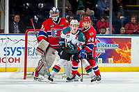 KELOWNA, CANADA - MARCH 13: Bailey Brkin #31 defends the net as Ty Smith #24 of the Spokane Chiefs back checks Kyle Topping #24 of the Kelowna Rockets as he looks for the pass on March 13, 2019 at Prospera Place in Kelowna, British Columbia, Canada.  (Photo by Marissa Baecker/Shoot the Breeze)