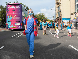 """© Licensed to London News Pictures; 12/09/2020; Bristol, UK. An """"NHS Workers say NO!"""" protest with a rally and march takes place through the city centre. The event is part of a national day of protest held in solidarity with health and social care workers across the UK demanding fair recognition of everyone in the NHS family and their tireless work throughout the coronavirus covid-19 pandemic. The campaign says """"If you clapped for us, please come and stand with us."""" The campaign says it is a disgrace that so many health and social care staff who worked so hard and risked their lives have been overlooked in the public sector pay rise, and that without nurses, health care assistants, porters, cleaners and the whole NHS family the UK could not have made it through. The campaign says that for too long this work has been underpaid and undervalued and now the UK government is squeezing the NHS from all sides, and they say NO to privatisation, deliberate underfunding, low wages and poor conditions. Organisers asked that all attendees respect social distancing as much as possible and with a planned route that gives as much space as possible and that mask wearing will be mandatory with masks available on the day for those that don't have them. Attendees are asked to wear blue, or a blue ribbon in solidarity. Photo credit: Simon Chapman/LNP."""