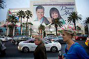 """People and traffic pass the Flamingo casino, featuring a huge advertisement of Donny and Marie Osmond in the """"strip"""" in Las Vegas, Nevada."""