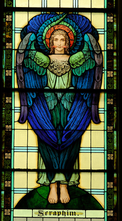 An angel representing Seraphims, one of nine Choirs of Angels,is depicted in a stained glass window at Our Lady of the Lake Church in Ashland. (Sam Lucero photo)