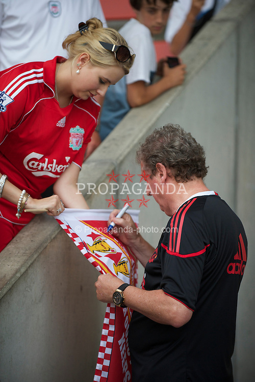 ZUG, SWITZERLAND - Wednesday, July 21, 2010: Liverpool's manager Roy Hodgson signs autographs for supporters before the Reds' first preseason match of the 2010/2011 season against Grasshopper Club Zurich at the Herti Stadium. (Pic by David Rawcliffe/Propaganda)