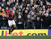 Photo: Lee Earle.<br /> Fulham v Arsenal. The Barclays Premiership. 04/03/2006. The Arsenal fans celebrate after Thierry Henry scored their third.