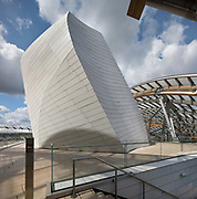 Glass 'sails' and white 'iceberg' of the Fondation Louis Vuitton, seen from a terrace, an art museum and cultural centre designed by Frank Gehry, b. 1929, and built 2008-14, next to the Jardin d'Acclimatation in the Bois de Boulogne, in the 16th arrondissement of Paris, France. The building resembles the sails of a boat and houses 11 galleries, an auditorium seating 350 and roof terraces. Picture by Manuel Cohen
