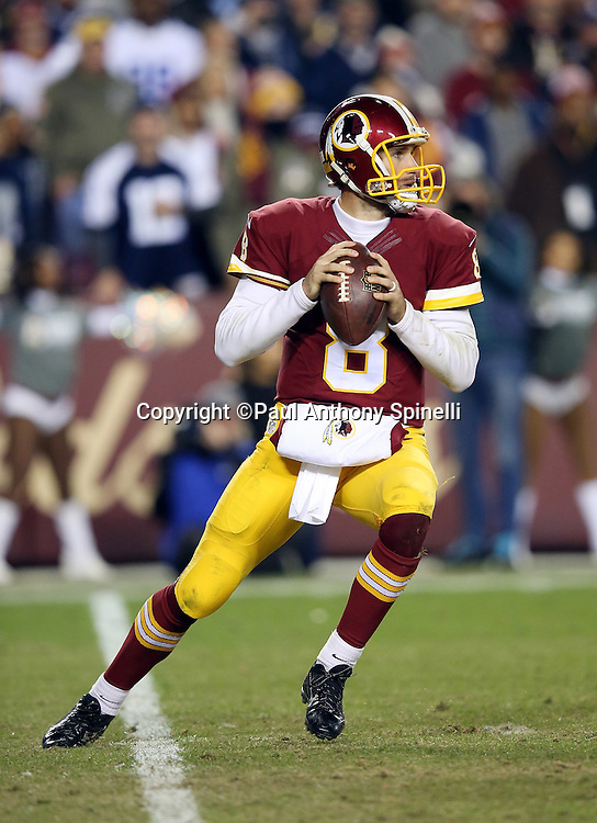 Washington Redskins quarterback Kirk Cousins (8) drops back to pass during the 2015 week 13 regular season NFL football game against the Dallas Cowboys on Monday, Dec. 7, 2015 in Landover, Md. The Cowboys won the game 19-16. (©Paul Anthony Spinelli)