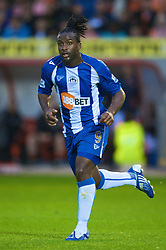 BLACKPOOL, ENGLAND - Wednesday, August 26, 2009: Shades of Jason Lee's 'Pineapple' hair cut... Wigan Athletic's Jason Scotland in action against Blackpool during the League Cup 2nd Round match at Bloomfield Road. (Photo by David Rawcliffe/Propaganda)